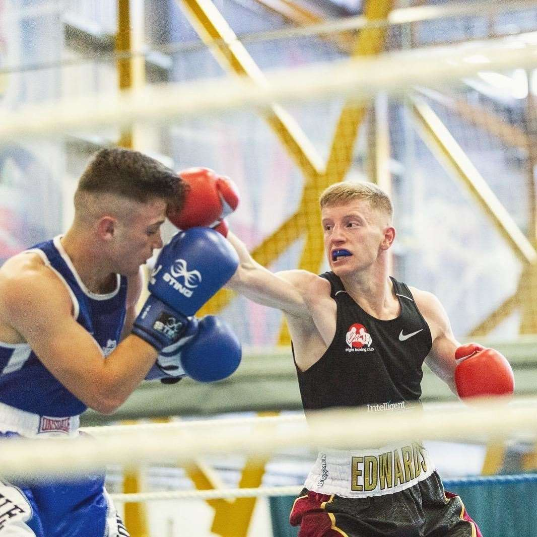 Fraser Edwards lands a punch during an earlier bout in the championship.