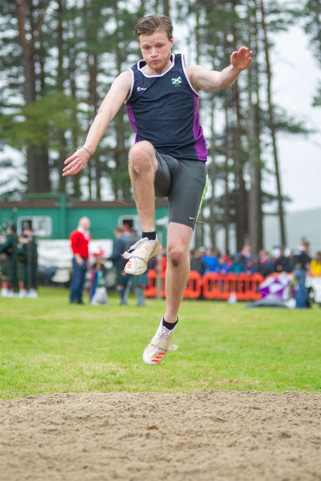 Findlay Donegan from Elgin competes in the long jump. Picture: Daniel Forsyth. Image No.044479.