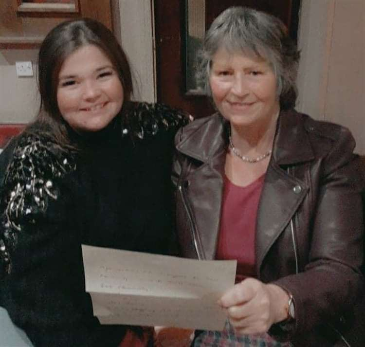 Lorna and her daughter Ashleigh Murdoch opening the letter of award.