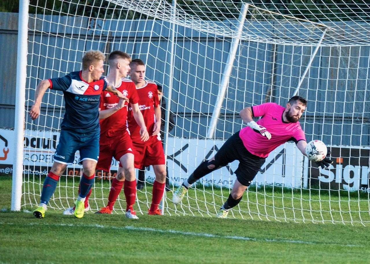 Picture taken at the Lossiemouth FC v Turriff Utd FC game and shows Lossie keeper Stewart Black getting a hand to the header from Turras Gavin Elphinstone..