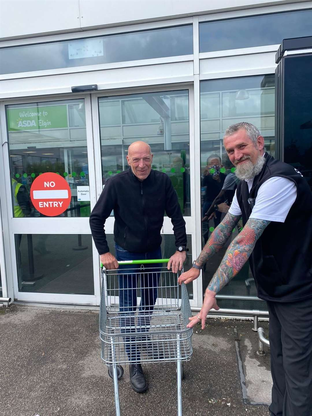 Glen Fraser, security guard at Asda Elgin, with a customer.