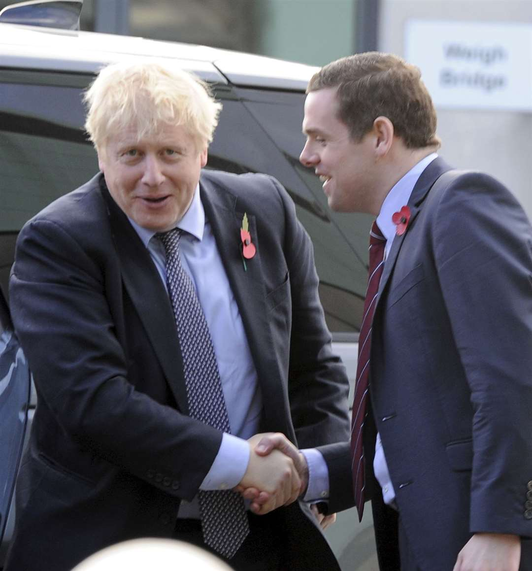 A handshake for PM Boris Johnson from Tory candidate Douglas Ross. Picture: Eric Cormack.
