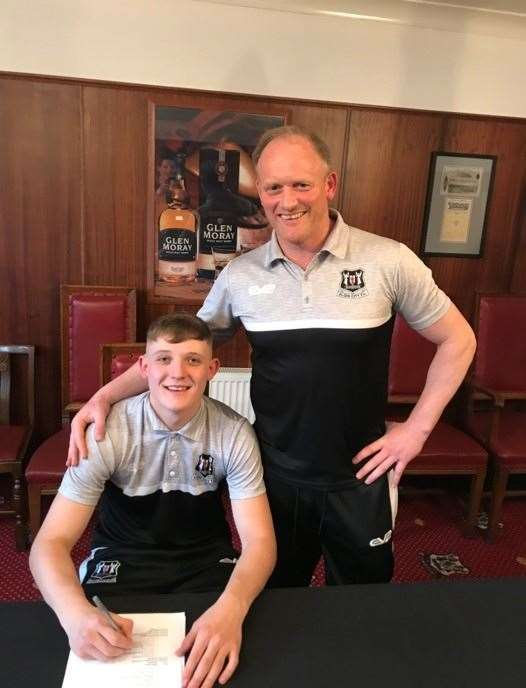 Owen Loveland with Elgin City manager Gavin Price after signing a first team contract with the Borough Briggs club.