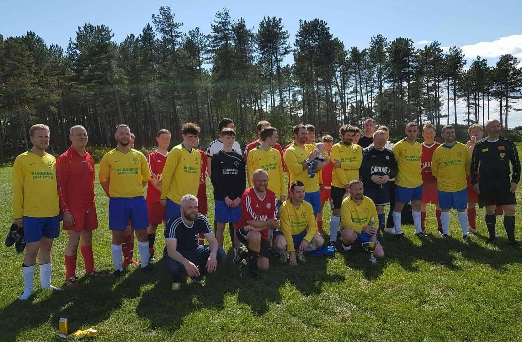 Burghead United players past and present took part in a match in memory of club stalwart Jim Attridge.
