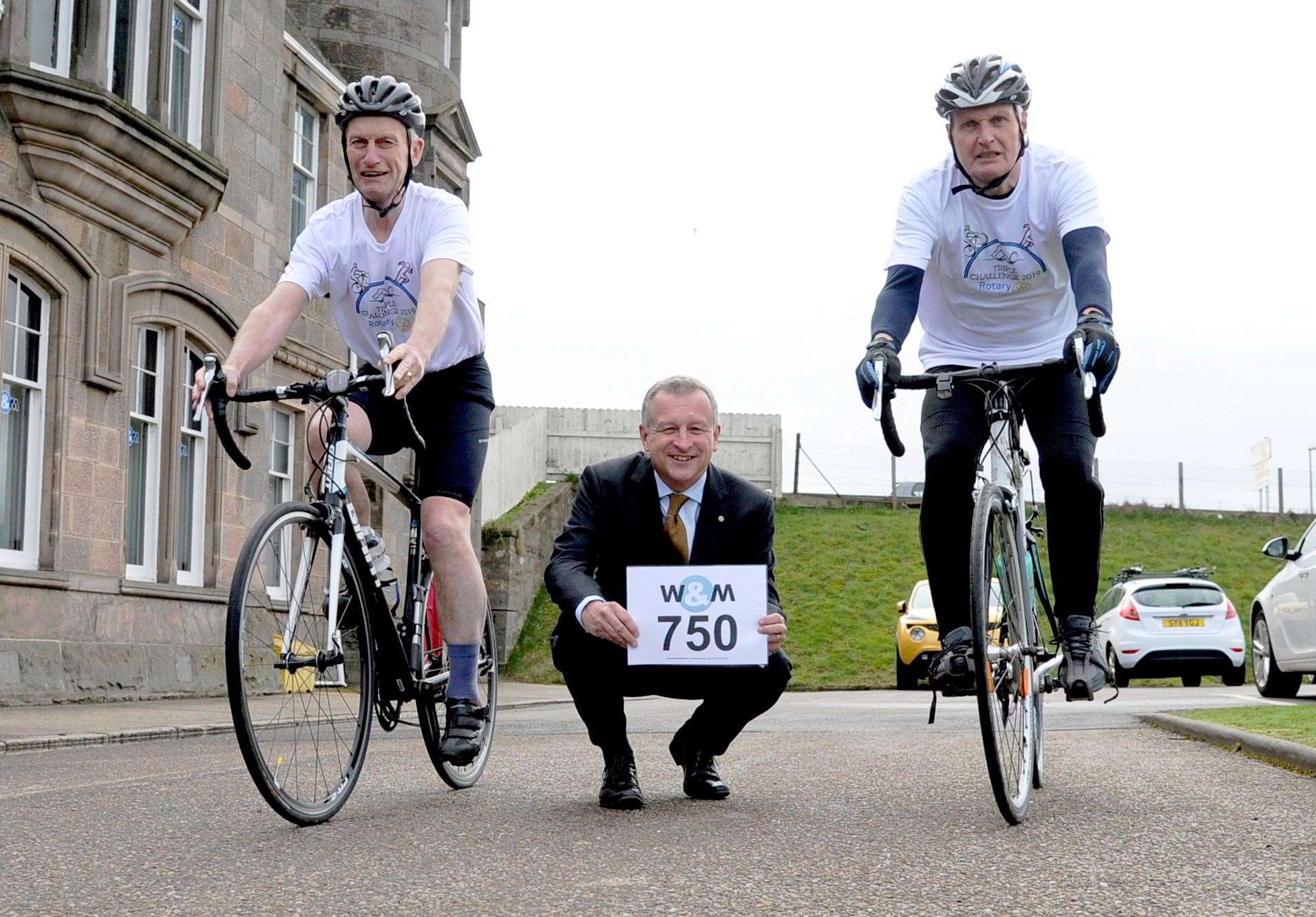 Sponsor for the cycling event, Wink and Mackenzie partner Ian Stewart (centre) with Rotarians George Duthie (left) and David Small.