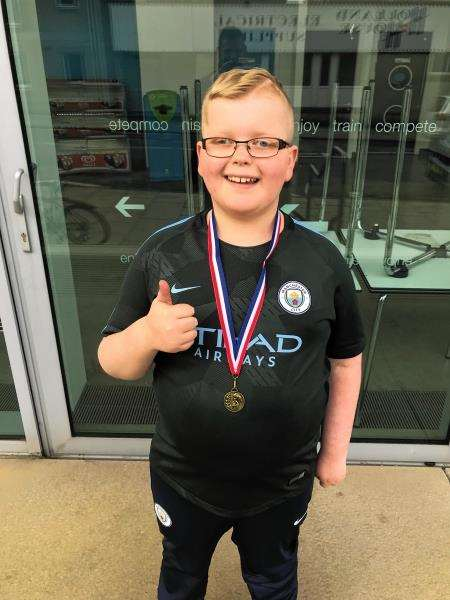 Daniel Strong shows off his gold medal at the Grampian Disability Games