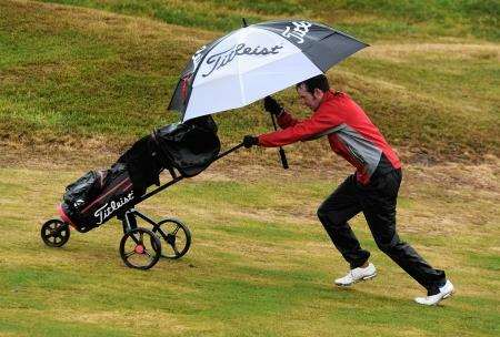 Louis Gaughan (Bathgate) battles the rain and wind at Moray Golf Club. Picture: Eric Cormack.